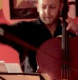Review: Cellist Throws Everything Into the Mix — and Then Some
