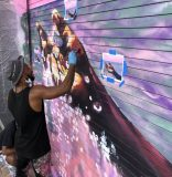 Local artist Mojo commissioned for murals that adorn new 545wyn building in Wynwood