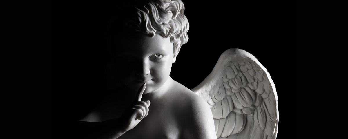 Cupid image, white on black background